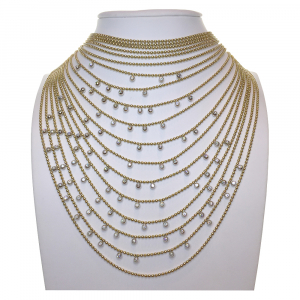 "Collier Cartier ""Draperie"" en or jaune, or blanc et diamants."