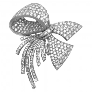 Broche Noeud en platine, diamants.