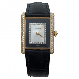 "Montre Cartier ""Tank Louis Cartier"" or jaune sur cuir, diamants, nacre."