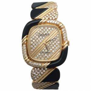 Montre Chaumet, DeLaneau en or jaune, diamants et onyx.