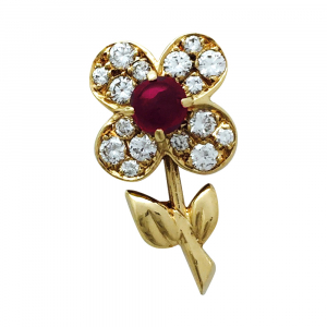 "Clip vintage Van Cleef & Arpels, collection ""Fleurette"", or jaune, diamants et rubis."