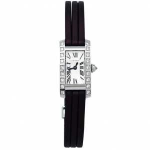 "Montre Cartier ""Mini Tank allongée"" en or blanc et diamants."