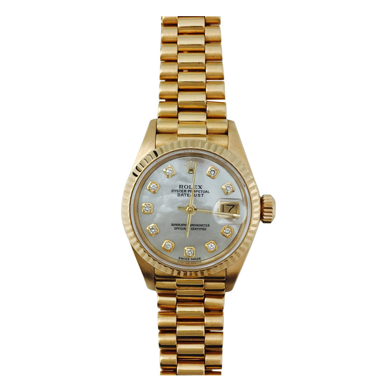 Montre Rolex Datejust Oyster Perpetual, or jaune, nacre blanche et diamants.